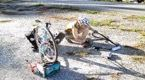 Image of person changing bicycle tires